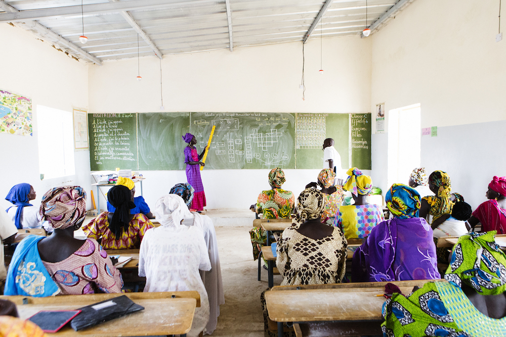 Above: Not only have the women of Latyr's Adult Literacy class learned how  to read and write—they are also using their education to change Latyr for  the ...