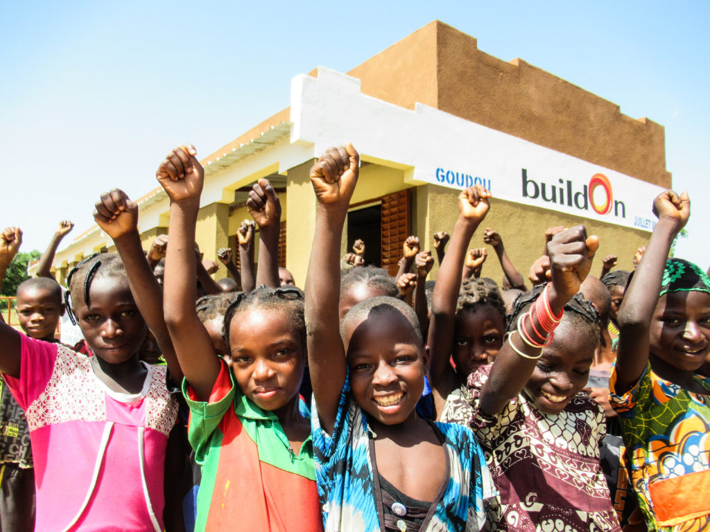 Students celebrating their new school in Goudou, Burkina Faso, built with buildOn and EAC.