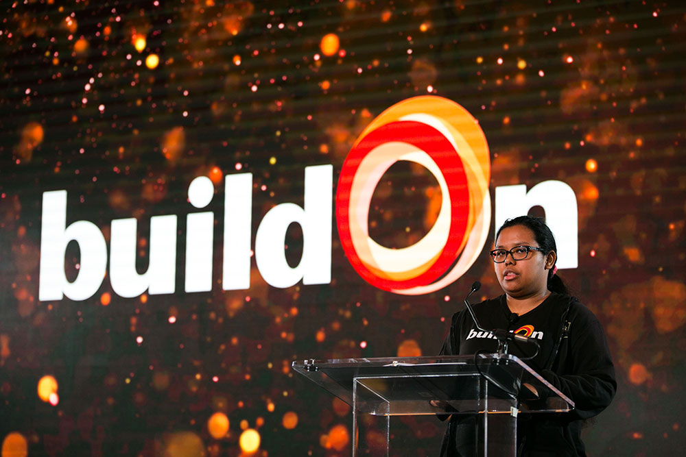 Anahi, a buildOn student from Richards Career Academy, shares what service means to her on the stage at the buildOn Breakfast.