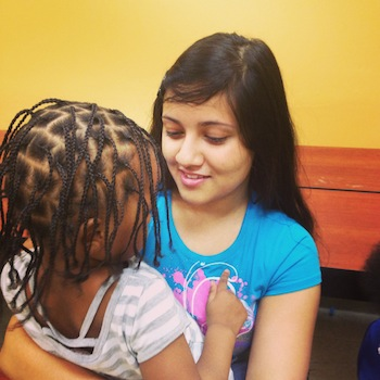 Fahmida Wahid, a student at Upper Darby High School, spends quality time with one of the children at Jane Addams Place.