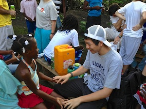 Ben plays game with one of the village girls in Haiti.