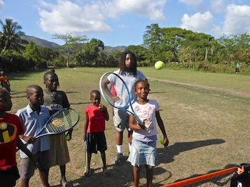 Students from Philadelphia's Legacy Youth Tennis and Education program teach Haitian villagers how to play tennis in between building a school in Menard.